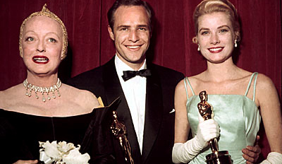 Marlon Brando with his trophy... and his Oscar...