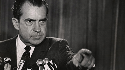 "Richard Nixon unsuccessfully attempts to distract from the Watergate scandal by declaring ""It's behind you!"" during a Press Conference..."