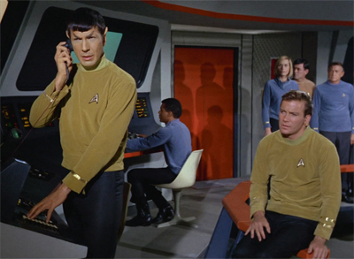 Spock serves to bridge the two pilots...