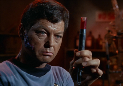 I do like how McCoy's lesions, shirt and research are all colour-coordinated...