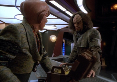 Wait... why did Quark need to let the guy carry his weapon to make this deal?