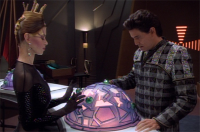 He doesn't seem too bothered about letting her play with his sphere...