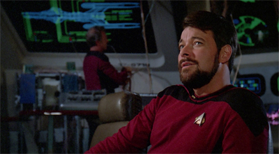 Riker looks like he's trying really hard to fight the urge to order a lazyboy installed as his command chair...