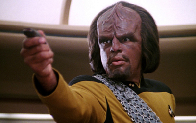 Um... where exactly does Worf keep that dinky phaser on his uniform without pockets?