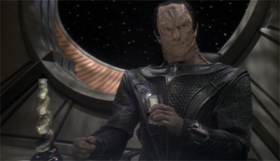 Dukat needs a stiff drink to help him process this plot...