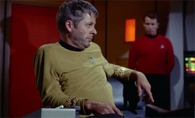 I have to admit, if I ever had to sit in the command chair, I'd probably sit like that...