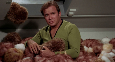 The image of Kirk buried in tribbles is hilarious. Until you remember that they are all dead or dying.