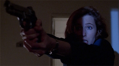 Scully has had it with Mulder's quips about her driving...