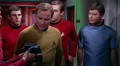 Holding Kirk's tricorder is possibly the safest assignment that a red shirt could ask for...