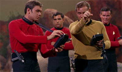 """You! Anonymous red shirt! Investigate that strange noise!"" Kirk demonstrates finely-honed survival skills."