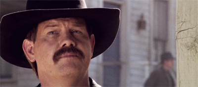 This man is the sheriff. You can tell by his awesome moustache.