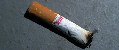 A smoking cigarette stub...