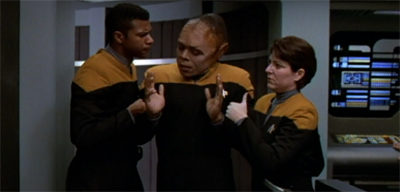 """Hands off the threads. I just got done putting Tuvok and Neelix's outfits through a transporter accident."""