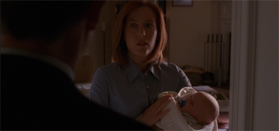 Scully is left, quite literally, holding the baby.