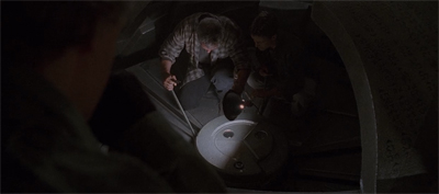 Yes, they are trying to jimmy the lock on an alien ship. The mythology has come to this.