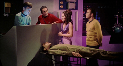 """Doctor McCoy has lost the surgical knowledge he obtained from the teacher. He has been drawing on his own skills and surgical techniques in an attempt to continue the operation, but he is faltering and uncertain. In a desperate hope that he can draw on Spock's brain for assistance, I instructed Doctor McCoy to give priority to connecting Spock's vocal chords."""