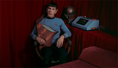 Spock lutes while the Enterprise burns... her engines out...