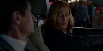 """Boy, Mulder. You sure were right. This Ford handles really well..."""