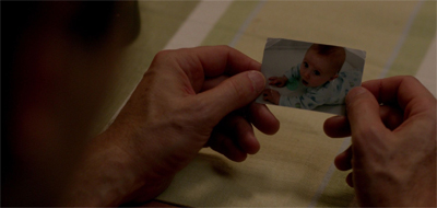 """Boy, I really wish Scully and I had more than one photo of the kid."""