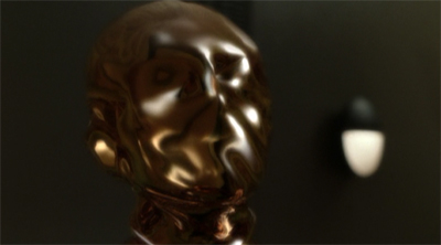 Odo's best impression of an Oscar statuette.