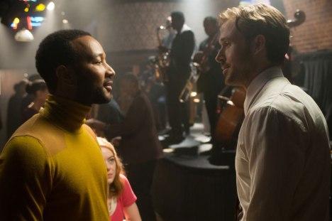 Ryan Gosling and John Legend in La La Land (2016) Titles: La La Land People: Ryan Gosling, John Legend Photo by Dale Robinette
